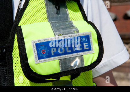Close up of the badge of the British Transport Police on a high visibilty vest, England. - Stock Photo