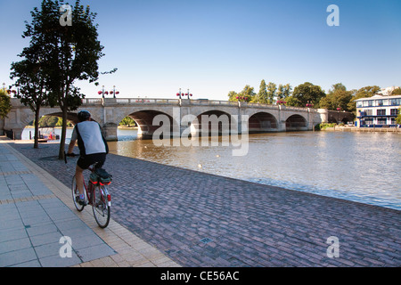 Cycling along the Thames Path / Cycle Path / Tow Path near Kingston Bridge, Kingston Upon Thames. - Stock Photo