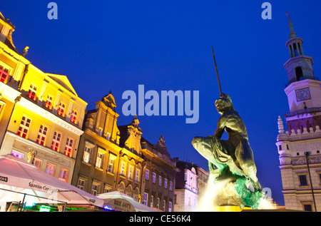 Fountain of Mars in the town square, Stary Rynek, with Town Hall behind, in the Polish city of Poznan, at night. - Stock Photo