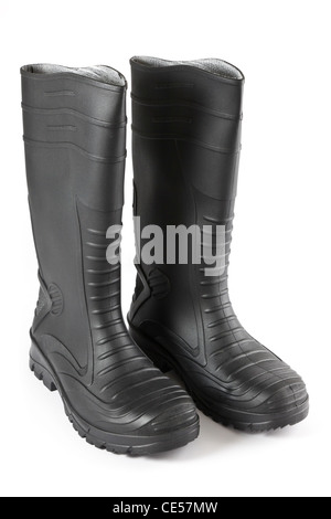 One pair of black rubber safety wellington boots isolated on a white background - Stock Photo