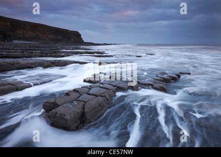 Waves rushing around broken ledges at Nash Point on the Glamorgan Heritage Coast, Wales, UK. Winter (December) 2011. - Stock Photo