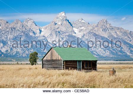 Small log cabin on Mormon Row, Antelope Flats Road, Grand Teton National Park, Wyoming, United States - Stock Photo