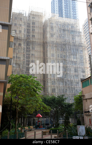 bamboo scaffolding and screens around building in smithfield kennedy town hong kong hksar china asia - Stock Photo