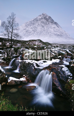 Waterfall on the River Coupall with Buachaille Etive Mor in the background. Winter view in Glencoe, Scottish Highlands - Stock Photo