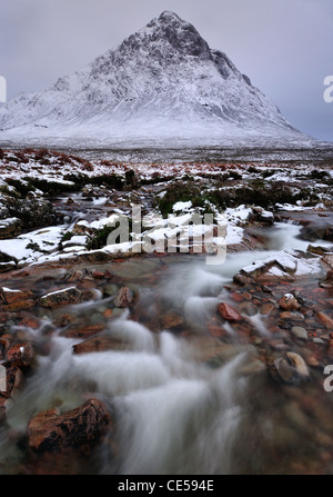 Flowing water in the River Coupall with the peak of Stob Dearg, Buachaille Etive Mor in the background - Stock Photo