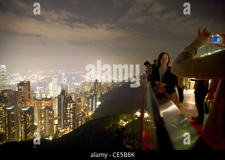 female tourists taking photos from the sky terrace on the peak hong kong hksar china asia - Stock Photo