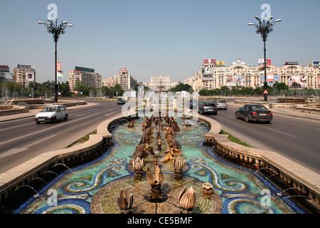Europe, Romania, Bucharest,Fountains on B-dul Unirii Boulevard - Stock Photo