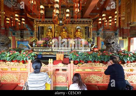 chinese women praying at po lin monastery ngong ping lantau island hong kong hksar china asia - Stock Photo