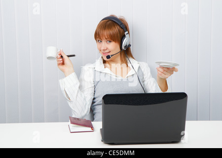 Employee assistance services online. Girl in a playful mood - Stock Photo
