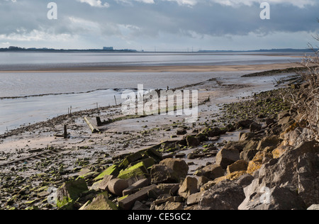 River Severn at low tide with evening sun in winter showing also old beached wooden boats - Stock Photo