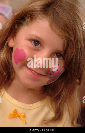 Portrait of a little girl with face paint