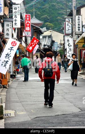 People walking on Matsubara Dori, commercial street, close to the Kiyomizudera temple in Kyoto, Japan - Stock Photo