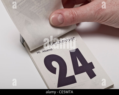 A calendar sheet is lifting and shows December 24th, Christmas Eve - Stock Photo