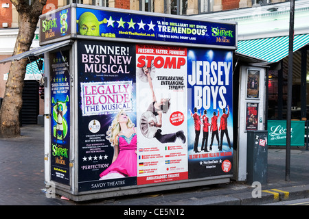 West End Charing Cross Road Cambridge Circus London newspaper kiosk vendor adverts posters billboards local shows - Stock Photo