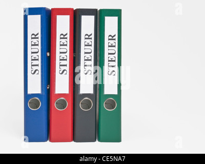 vier bunte, stehende Ordner beschriftet mit 'Steuer'   four colored files upright with the German label 'Steuer'(Tax) - Stock Photo