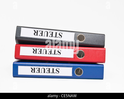 three colored files on top of each other with the German label 'Steuer'(Tax) - Stock Photo