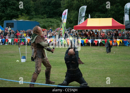 Two Men In Medieval Costume Sword Fighting At Jousting