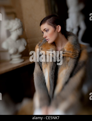 A young woman wearing a fur coat - Stock Photo