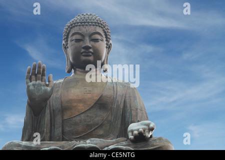 The Tian Tan Buddha (Big Buddha) in Hong Kong, China (with copy space) - Stock Photo