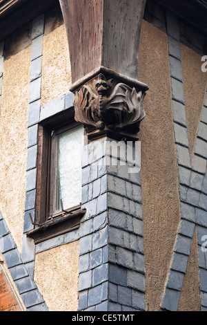 A carved figure of a dragon on an old house in Tours, France. - Stock Photo