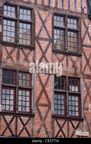 Detail of a timber framed house in Place Plumereau, Old Tours, France. - Stock Photo