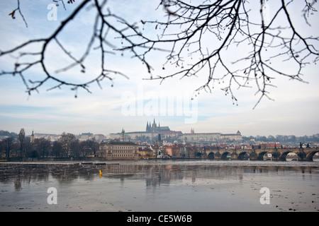 Charles Bridge, The Saint vitus Cathedral and the Mala Strana district over the Vlatava river, Prague, Czech Republic - Stock Photo