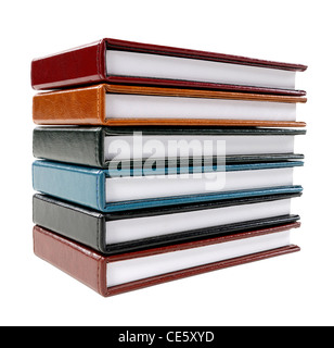 Stack of colorful note books, isolated on white - Stock Photo