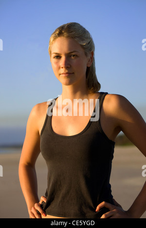 Young athletic woman with hands on hips - Stock Photo