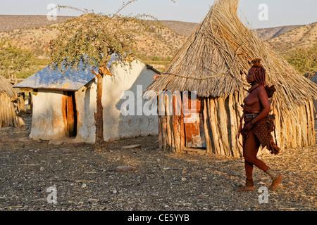 Himba woman in village near Opuwo, Namibia - Stock Photo