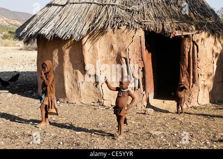 Himba children in village near Opuwo, Namibia - Stock Photo