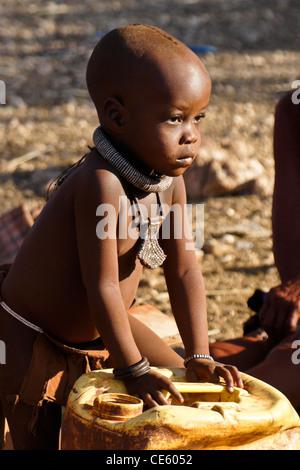 Himba child in village near Opuwo, Namibia - Stock Photo