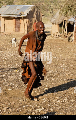 Himba man dancing in village near Opuwo, Namibia - Stock Photo