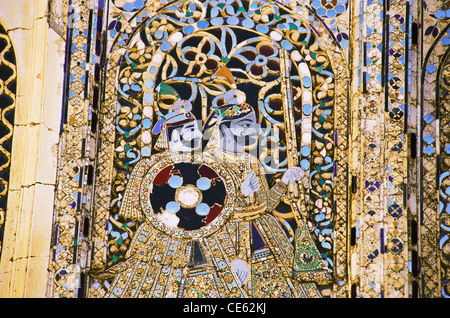 Glass and mirror inlay mosaic work peacock yard in City Palace Udaipur Rajasthan India - Stock Photo