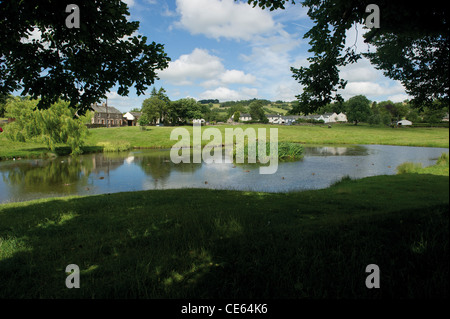 The duck pond in Caldbeck Cumbrian Village Lake District UK English Countryside - Stock Photo