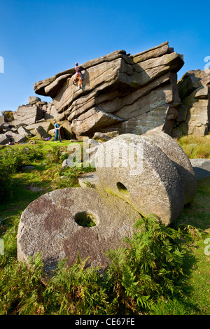 Two climbers practising above the old abandoned Millstones Stanage Edge Peak District Derbyshire England UK gb eu - Stock Photo