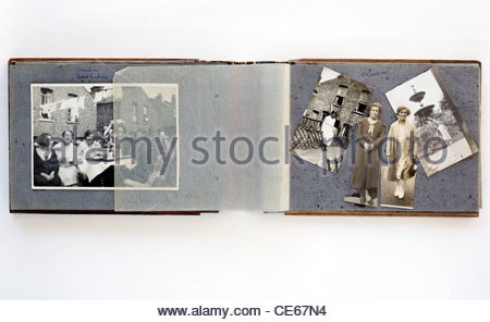open family photo album with cut and assembled images from 1920s England - Stock Photo