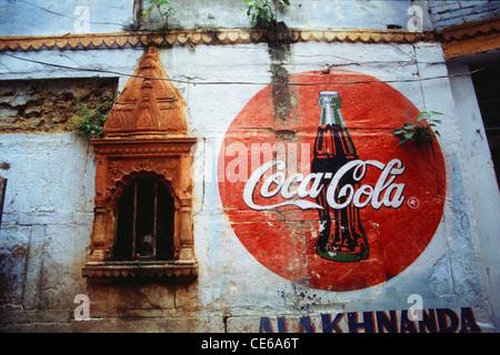Coca Cola painted on wall near temple Varanasi Uttar Pradesh India - Stock Photo