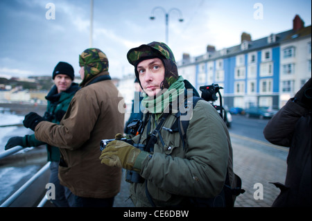 A group of birdwatchers ornithologists fwatching the starlings roosting in Aberystwyth Wales UK. - Stock Photo