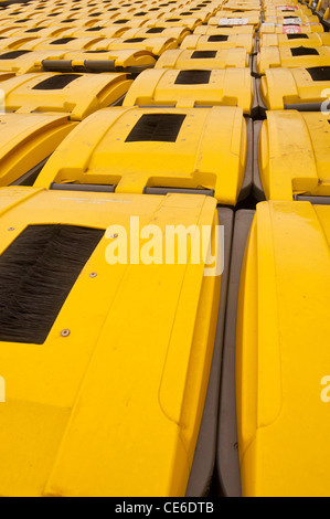 Many plastic recycling refuse bins in rows - Stock Photo