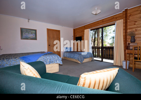 Nice warm interior of mountain wooden lodge apartment. Fox Glacier Lodge, Fox Glacier, West Coast, South Island, - Stock Photo