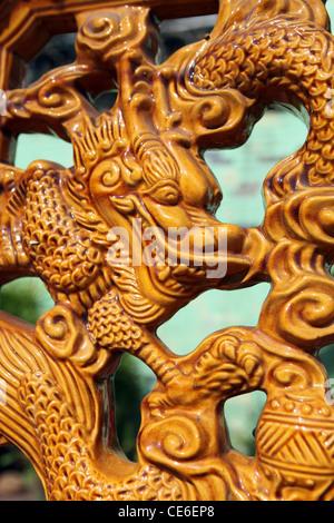 Dragon sculpture on Chinese temple wall in Chinatown. Kuala Lumpur, Wilayah Persekutuan, Malaysia, South-East Asia, - Stock Photo