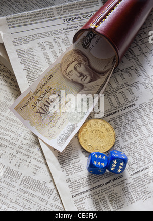 FORMER 1,000 GREEK DRACHMA BANKNOTE WITH 1 GOLD ECU - European Currency Unit - COIN + SHAKER + 2 DICE ON FINANCIAL - Stock Photo