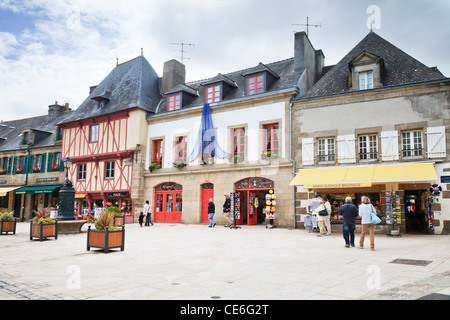 People strolling in the Town Square of Concarneau, Brittany, France. - Stock Photo