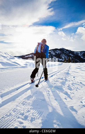 A woman cross country skiing on the Trails near Sun Mountain Lodge in the Methow valley, Washington, USA. - Stock Photo