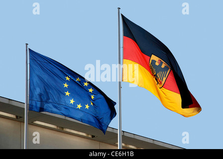 Flags of the European Union and the Federal Republic of Germany at the mast in front of the Federal Chancellery - Stock Photo