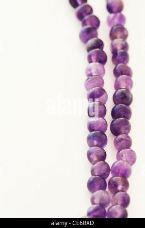 Amethyst Japa Mala prayer beads on white background - Stock Photo