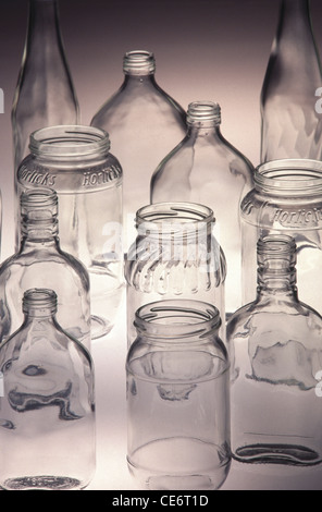 HMA 85027 : 10 ten empty transparent different shapes and various sizes glass bottles on white background india - Stock Photo