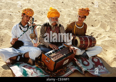 Rajasthani folk musicians playing musical instrument harmonium violin drum desert rajasthan india - MR#657A - bdr - Stock Photo