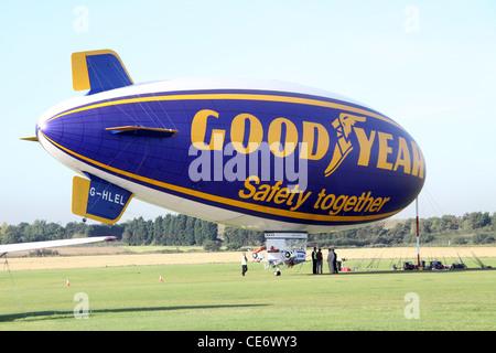 Goodyear Blimp tethered on ground - Stock Photo