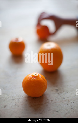 Child's hand reaching for orange - Stock Photo